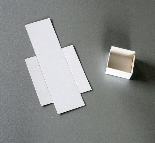 Folded boxes, white, 70 for 1 flat