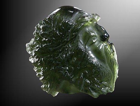 Vltavín, glyptika - hlava muže