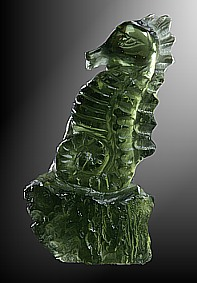 Moldavite, seahorse on rock